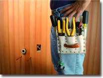 Image of electrician and toolbelt